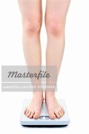 Slender female legs standing on bathroom scale Stock Photo - Budget Royalty-Free, Image code: 400-05383426