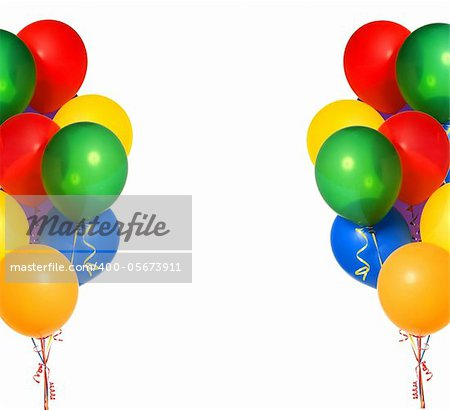 Colorful flying balloons on white