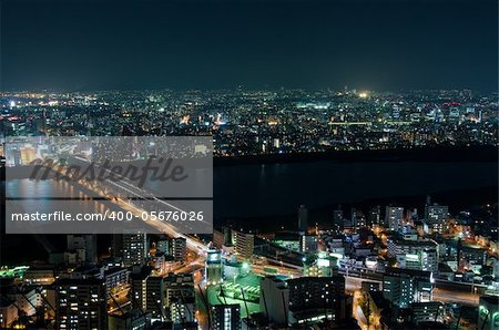Skyline of Suita and Toyonaka City in Japan at night with lots of lights