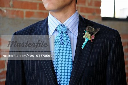 Image of a Blue Pinstriped Suit with Tie and Boutonniere Stock Photo - Budget Royalty-Free, Image code: 400-05678500
