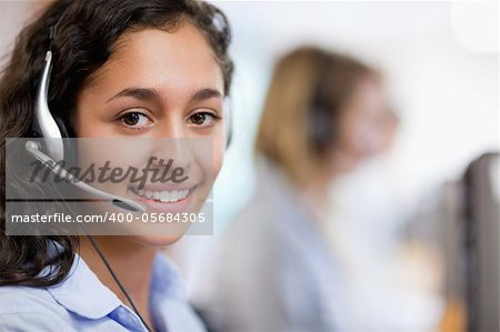 Close up of a customer assistant wearing a headset