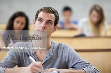 Students taking notes in an amphitheater with the camera focus on the foreground Stock Photo - Budget Royalty-Free, Image code: 400-05684315