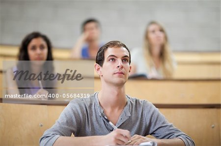 Students listening during a lecture in an amphitheater Stock Photo - Budget Royalty-Free, Image code: 400-05684319