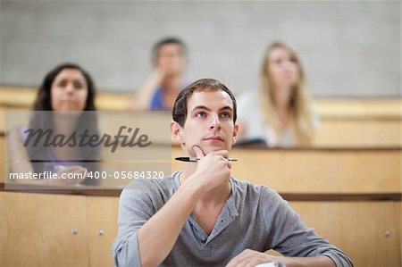 Students listening during a lecture in an amphitheater Stock Photo - Budget Royalty-Free, Image code: 400-05684320