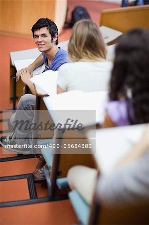 Portrait of a handsome student being distracted in an amphitheater Stock Photo - Budget Royalty-Free, Image code: 400-05684380