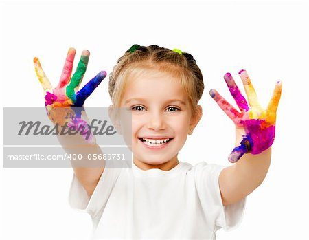 beautiful little girl with her â??â??hands in the paint