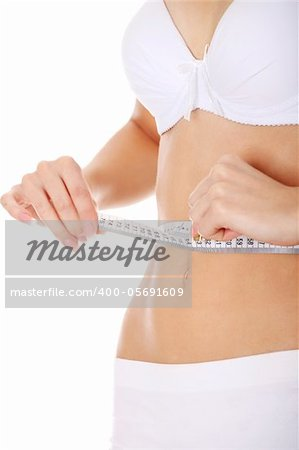 Beautiful woman measuring her perfect shape of beautiful thigh waist. Healthy lifestyles concept . Isolated Stock Photo - Budget Royalty-Free, Image code: 400-05691609
