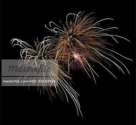 Firework display against black sky