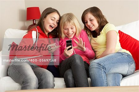 Group Of Three Girls Reading Text Message