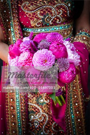 Image of an Indian brides hands holding bouquet Stock Photo - Budget Royalty-Free, Image code: 400-05697301