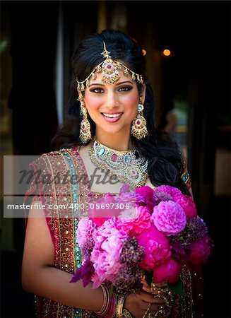 Image of a smiling Indian bride holding bouquet Stock Photo - Budget Royalty-Free, Image code: 400-05697308