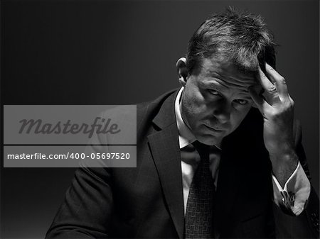 Portrait Of Stressed Businessman Stock Photo - Royalty-Free, Artist: MonkeyBusinessImages, Code: 400-05697520