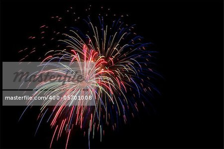 Colorful fireworks isolated over a dark background