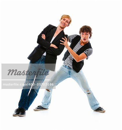 Two modern teenage boys having fun. Isolated on white Stock Photo - Budget Royalty-Free, Image code: 400-05703086