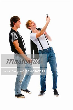 Two modern teenage boys making photos on cell phone. Isolated on white Stock Photo - Budget Royalty-Free, Image code: 400-05703092