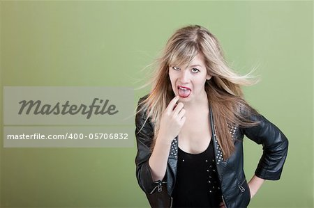 Retro-styled young woman points finger in her mouth Stock Photo - Budget Royalty-Free, Image code: 400-05706832