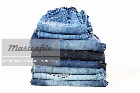 Stack of different jeans on white background Stock Photo - Budget Royalty-Free, Image code: 400-05708133