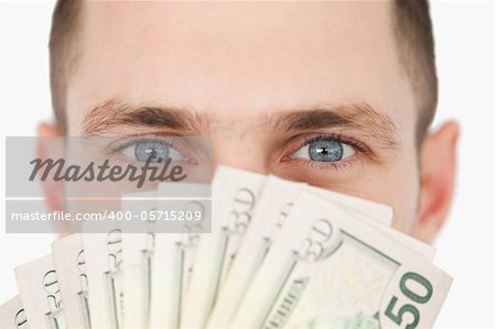 Close up of a rich businessman against a white background