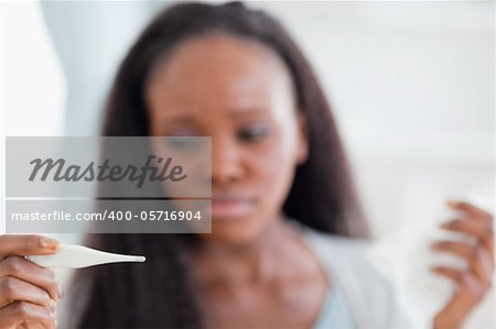 Close up of thermometer being used by young woman Stock Photo - Budget Royalty-Free, Image code: 400-05716904