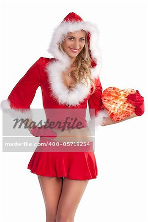 very sexy and attractive smiling blond girl in red santa claus costume keeping a gift box over white