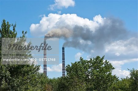 Smoke from factory pipes against a background of cloudscape