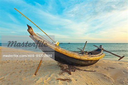 Old fisherman boat at sunrise time. Hue province. Vietnam Stock Photo - Royalty-Free, Artist: GoodOlga, Code: 400-05722880