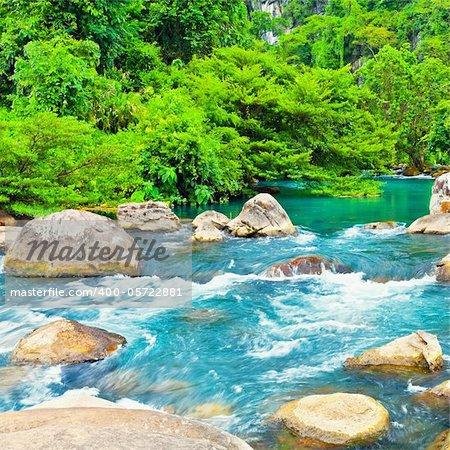 Blue water stream. Phong Nha - Ke Bang National Park. Vietnam Stock Photo - Royalty-Free, Artist: GoodOlga, Code: 400-05722881