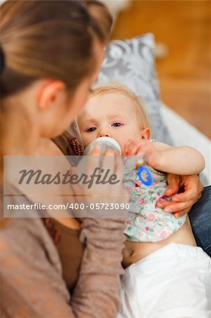 Mother feeding her baby at home