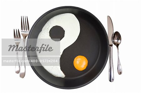 YIn-Yang eggs in a frying pan over white