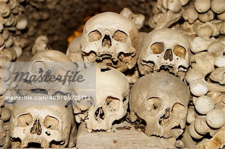 Six human skulls are piled on top of each other in the Sedlec ossuary (or bone church) located in the Czech Republic near the town Kutna Hora. A scary image for Halloween!