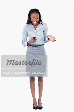 Portrait of a surprised businesswoman reading a text message against a white background Stock Photo - Budget Royalty-Free, Image code: 400-05729309