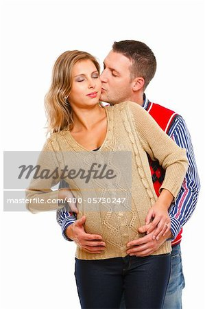 Young husband kissing his pregnant wife  on white background Stock Photo - Budget Royalty-Free, Image code: 400-05730247