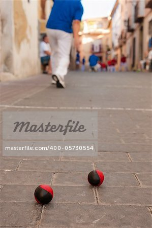 Traditional Spanish pelota match played on a cobblestone street
