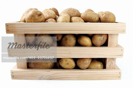 whole potatoes in wooden box