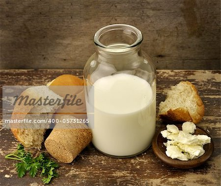 A Bottle Of Milk With Bread And Cheese