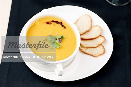 Puree of squash soup with smoked cheese and croutons