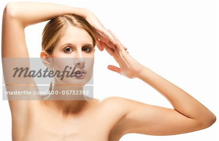 beautiful woman holding arms over her head on white background