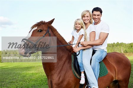 Family with daughter on a horse