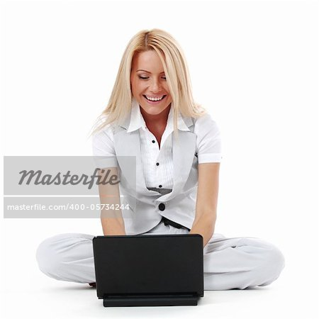 business woman lies and working on laptop