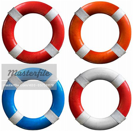 Four life buoys of various colors: red and white, orange and white, blue and white