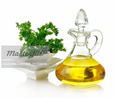Cooking Oil And Parsley On White Background