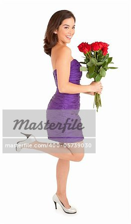 Woman in an evening dress is happily holding roses she just received Stock Photo - Budget Royalty-Free, Image code: 400-05739030