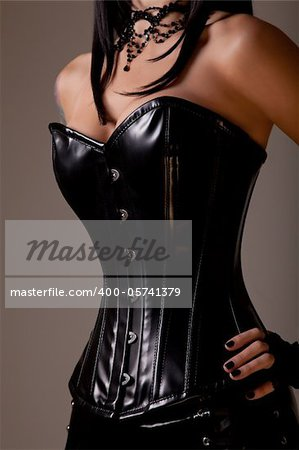 Slim sexy woman with hourglass figure in black leather corset, studio shot Stock Photo - Budget Royalty-Free, Image code: 400-05741379