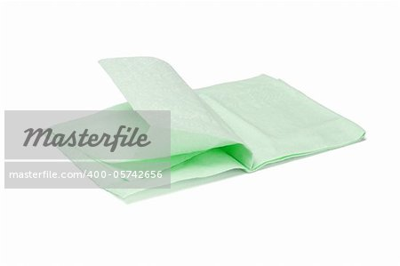 Green folded facial tissue paper on white background