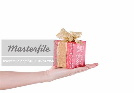 Hand with red gift isolated over white background
