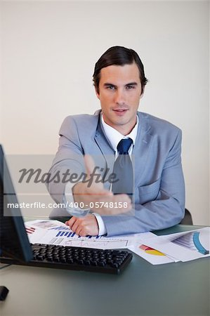 Sitting businessman offering his hand