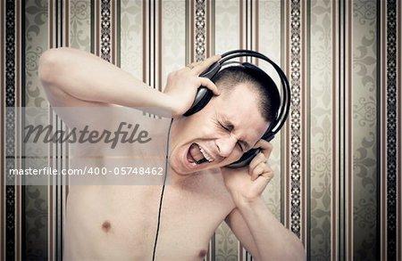 Young man enjoying music on headphones