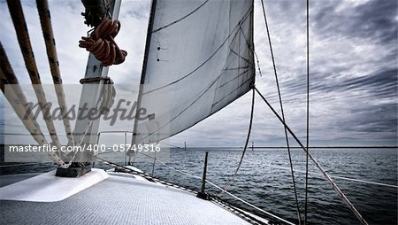 A yacht travelling through a storm Stock Photo - Budget Royalty-Free, Image code: 400-05749316