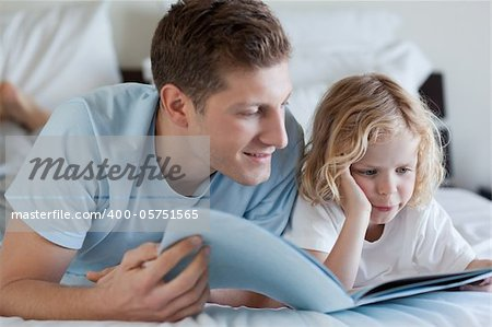 Father and son reading a magazine together