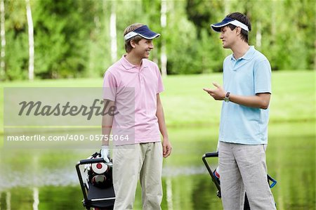 Young man talking on the golf course